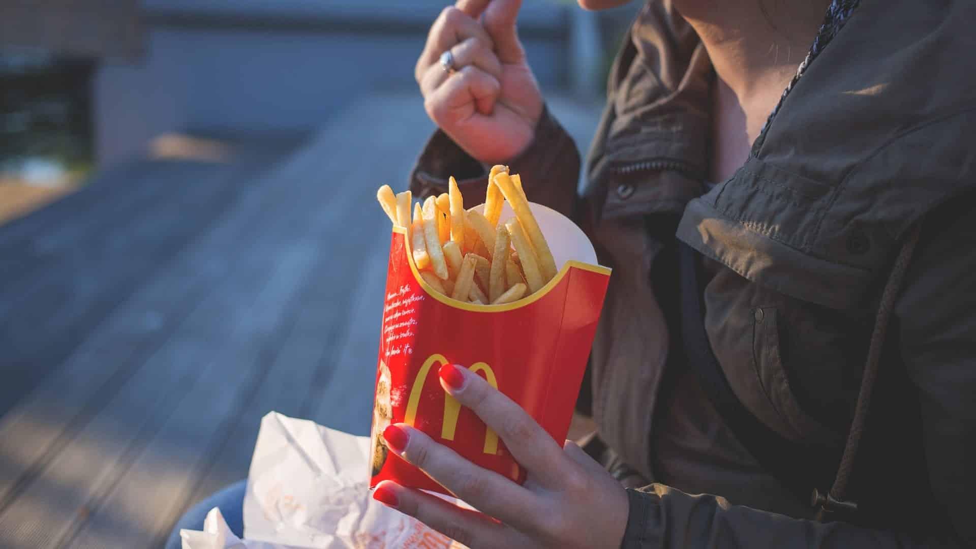 Lady eating Macdonalds Fries