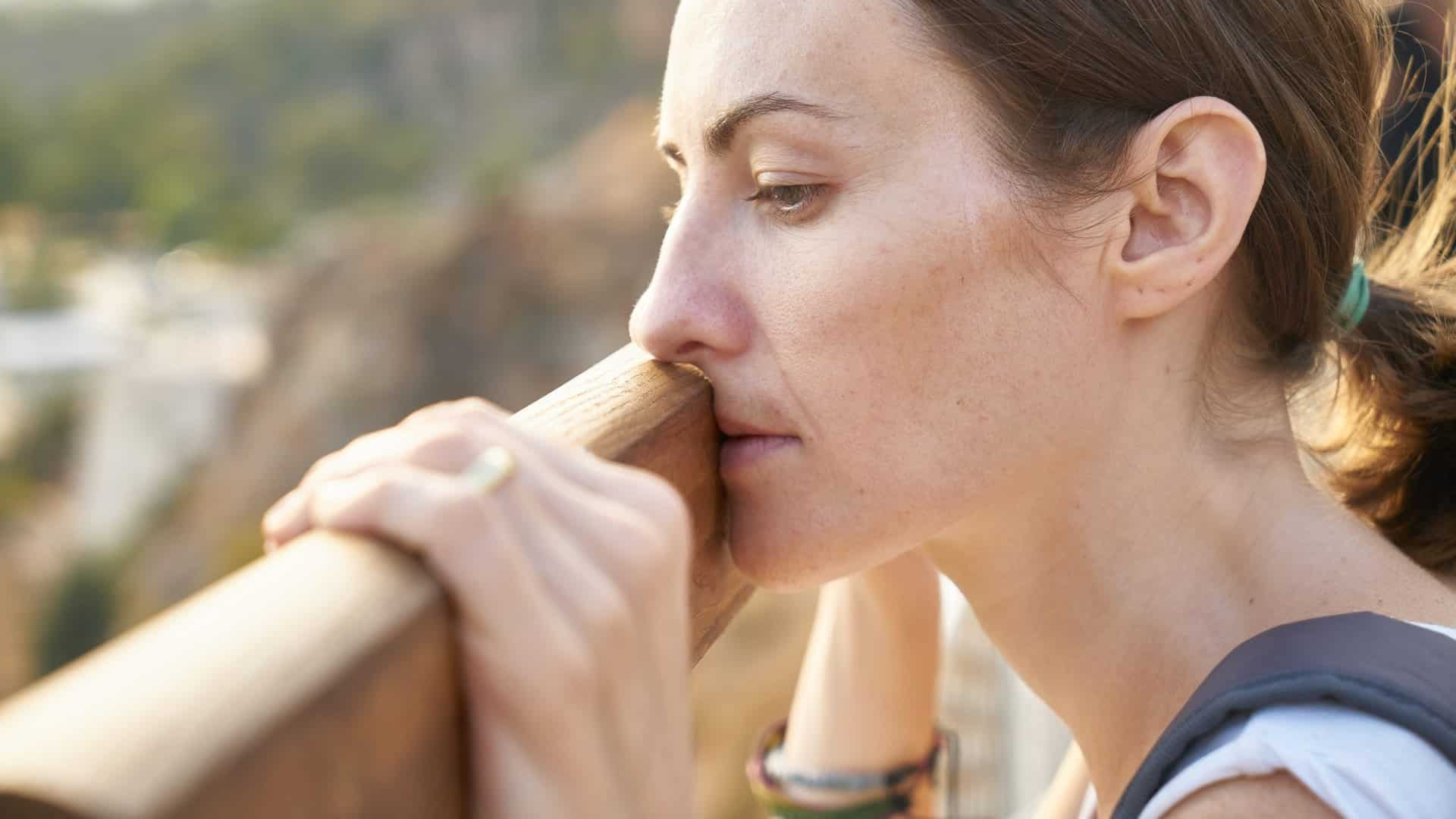 Woman looking out in deep thought