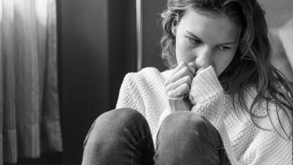 Anxious woman sat along