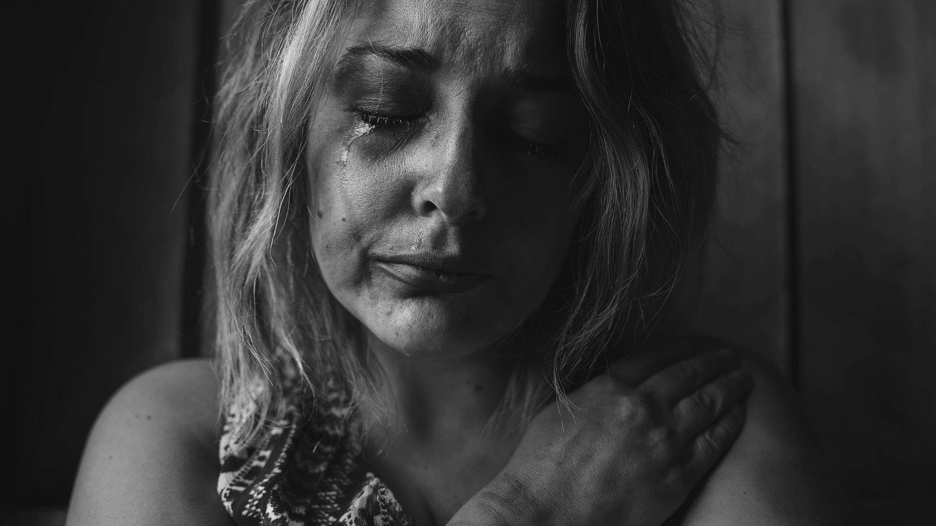 Woman crying in black and white