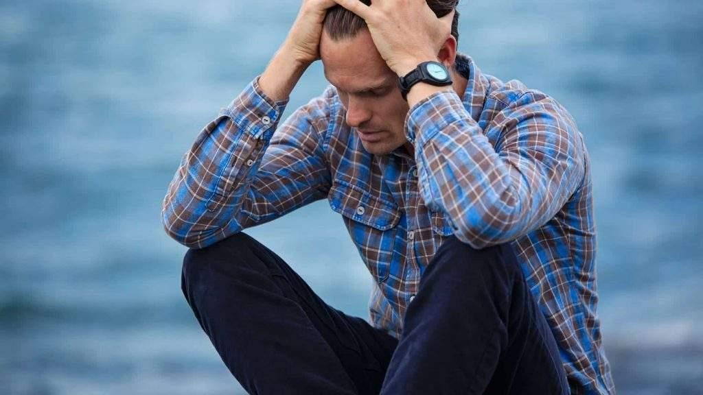 Man struggling to cope