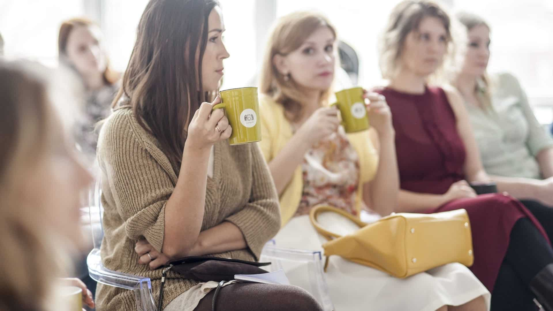 Group of women sitting drinking coffee