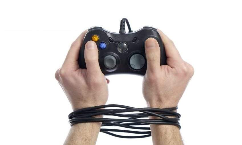 Gaming addiction image of xbox hands tied