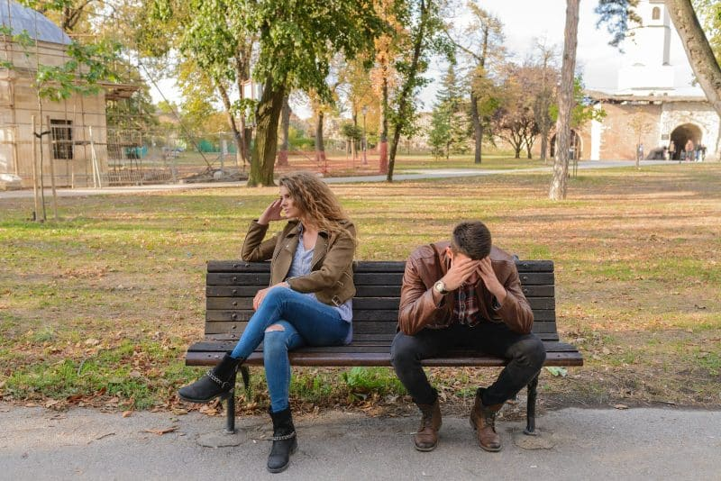 Couple sitting on the bench after an argument
